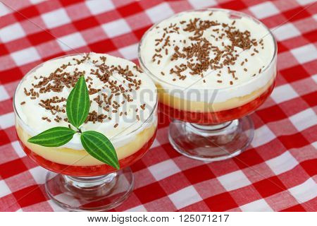 Two English trifles on red and white checkered cloth