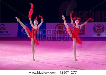 MOSCOW RUSSIA - FEBRUARY 21 2016: Rhythmic gymnasts Dina and Arina Averina Russia at the gala concert Grand Prix Moscow - 2016 in Moscow sport palace Luzhniki Russia