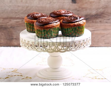 Lighter chocolate cupcakes on stand selective focus