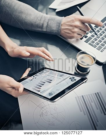 Analytical department working process.Closeup woman showing business reports modern tablet screen.Statistics graphics screen.Banker holding pen for signs documents, discussion startup. Vertical