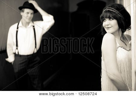 Young Flapper Girl Flirting With Young Man Outside Hotel Room.