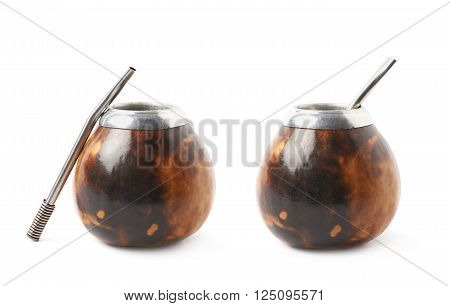 Calabash mate gourd with a bombilla drinking straw inside it, composition isolated over the white background, set of two different foreshortenings