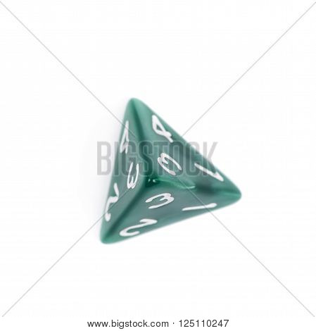 Green roleplaying polyhedral tetrahedron gaming plastic dice isolated over the white background