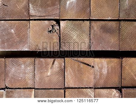 wood construction materials for building industry closeup of wood beam post ends stacked
