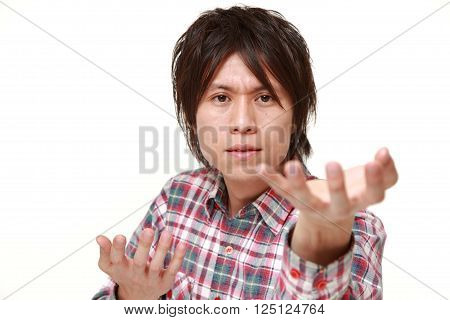 portrait of young Japanese man requests something