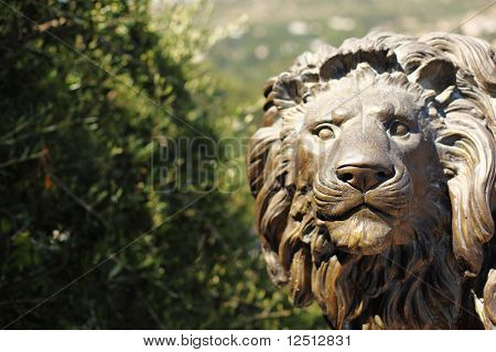 lion statue in park park on background
