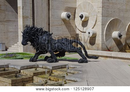Yerevan, Armenia -September 14, 2013. Armenian scene: Urban sculpture in Yerevan the lion from tires in the center of Yerevan