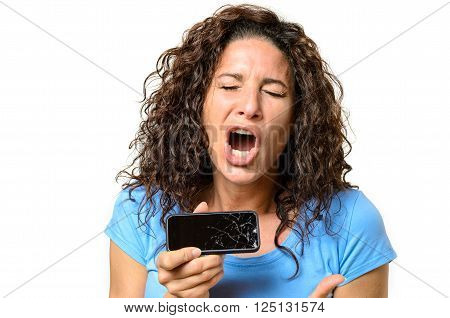 Emotional Woman Holding A Broken Mobile Phone