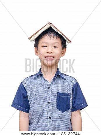 Asian student  with a book on his head isolated over white