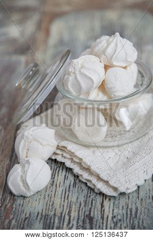 White marshmallows in glass jar on table