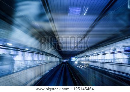 tunnel in tokyo at night blurred as idea of speed