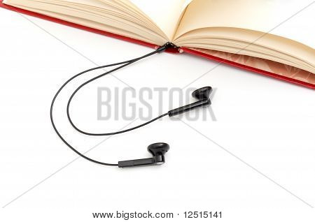 The audio-book concept. Opened book with headphones. poster