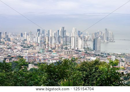 Panama City Panama - August 28 2015: Panama city skyline is seen from the top of Ancon hill on August 28 2015 in Panama Central America. Panoramic view