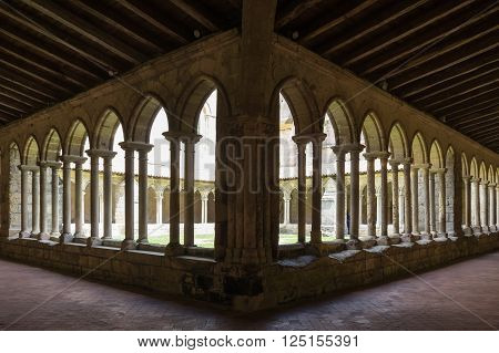 The Collegiate Church and Cloister in the centre of Saint-Emilion France poster