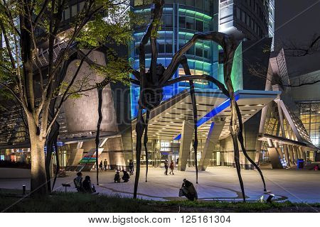 Tokyo, Japan - April 20, 2014: View of Roppongi Hills Mori Tower entrance. Mori is a 54-story mixed-use skyscraper completed in 2003. It is the centerpiece of the Roppongi Hills urban development.