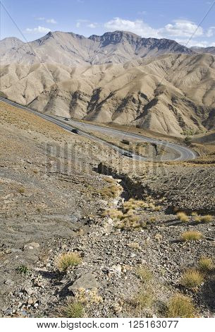 Cutting through the highest reaches of the Atlas Mountains the Tichka Pass offers views of the Moroccan hinterlands. Also known as the Tizi-n-Tichka is located at the countryside beyond Marrakech or travel to Ait Benhaddou poster