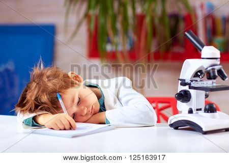 Tired Kid Fell Asleep After Conducting Experiment In School Lab