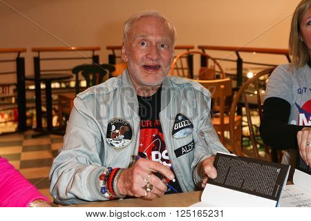 HUNTINGTON, NY-APR 5: Former astronaut Buzz Aldrin signs his book