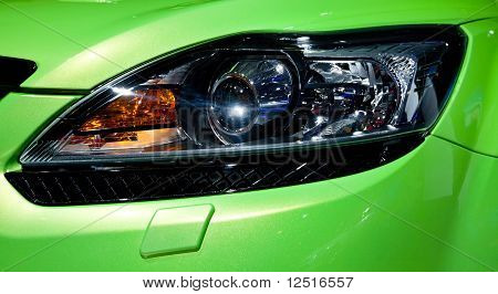 Plastic Headlight Of Green Sport Cars