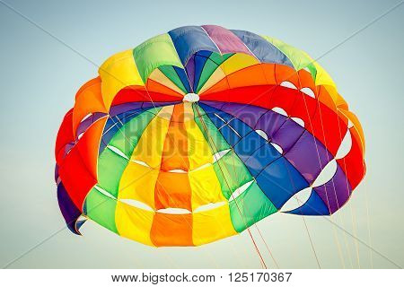 Bright multy color parachute close up in the sky
