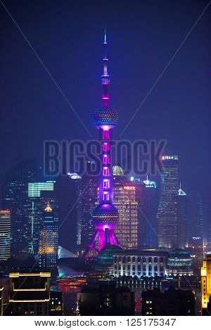 SHANGHAI, CHINA - MARCH 19, 2014: Famous Oriental Pearl radio and TV tower in Shanghai at night.