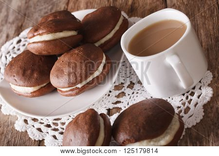 Tasty Whoopie Pie And Coffee With Milk Close-up. Horizontal