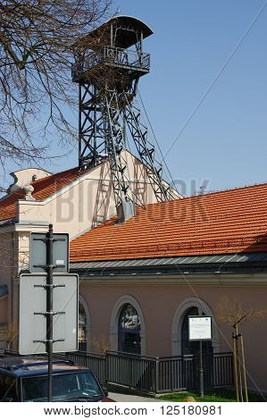 "Wieliczka, Poland - April 04, 2016: Sikorskiego street. ""Regis"" - the historic salt mine shaft. The historic mine is now a tourist attraction. poster"