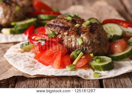 Turkish Kofta With Fresh Vegetables On A Flat Bread Close Up. Horizontal