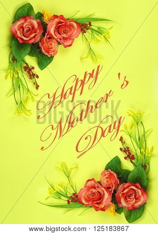 Cheerful silk flowers form a lower left and upper right corner borders on yellow background.Message for Mother's Day.
