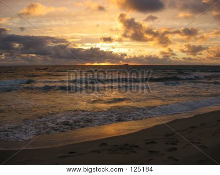 Sunset Over The Ocean At A Beach