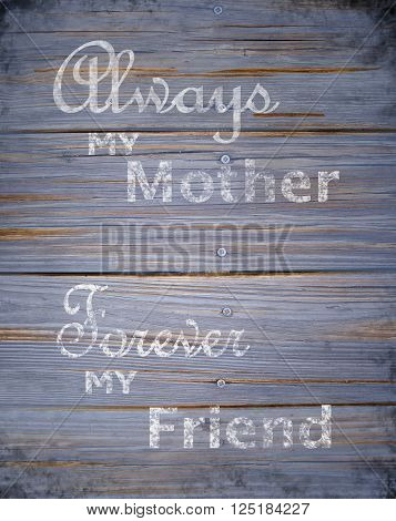 Rustic Mother's Day greeting on blue toned wood texture with grunge vignetting added. The text message is rough and faded. Vertical composition