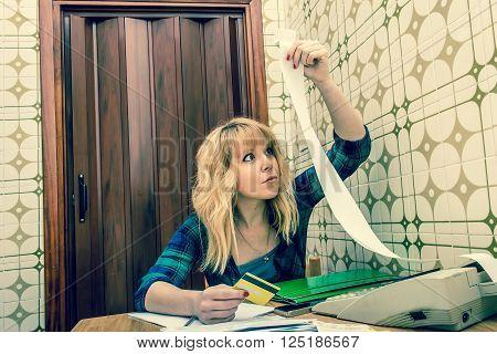 young woman checking home bills and bank or credit card accounts balance