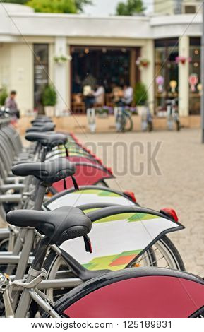 Row of city bikes for rent in Moskow, Russia. focus on the nearest Grips steering ** Note: Shallow depth of field
