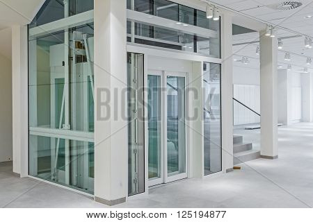 Staircase and elevator in a business centre shopping mall.