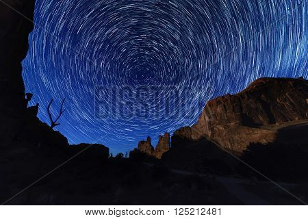 Circle light of star trails at Arches National park Utah USA huge rock as a fore ground