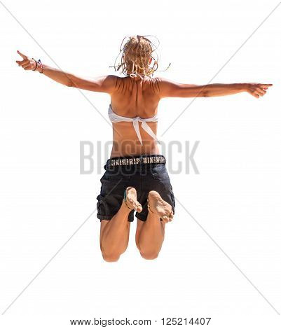 Back of happy and attractive woman with white bikini and shorts jumping in the air. Isolated on white background.