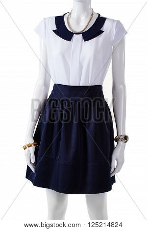 Mannequin wearing short sleeve blouse. White blouse with navy collar. Elegant blouse and wrist accessories. Lady's light top and watch.