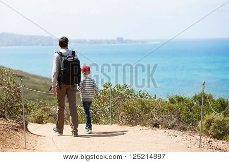 young active family of two hiking in torrey pines state natural reserve concept of active and healthy lifestyle