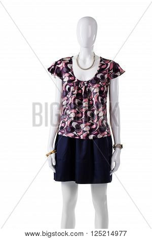 Colorful pattern blouse on mannequin. Short blouse with u-neck. Trendy casual short sleeve blouse. Girl's attractive casual outfit.