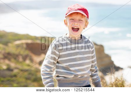 cheerful excited boy enjoying nice weather at torrey pines state natural reserve southern california coast emotion concept