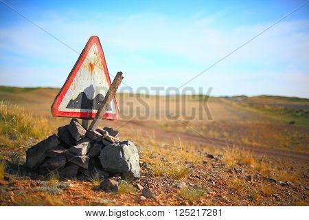 Broken rough road sign somewhere in Kazakhstan, Central Asia
