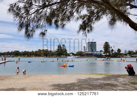 MANDURAH,WA,AUSTRALIA-MARCH 7,2014: Families on the foreshore in Mandurah, Western Australia taking kayaking lessons in the Peel-Harvey Estuary.