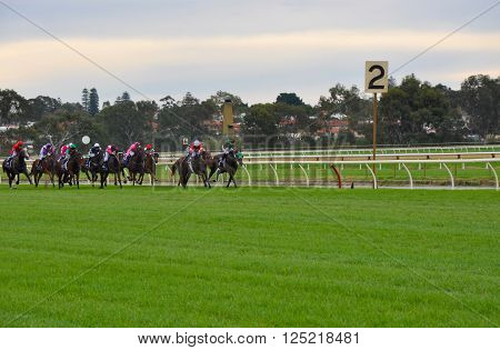 BURSWOOD,WA,AUSTRALIA-MAY 30,2014: Jockeys horse racing at the Belmont Park Racecourse in Burswood, Western Australia.