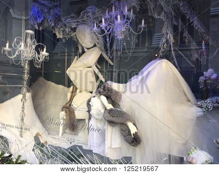 NEW YORK, NY - DEC 20: Holiday window display at Saks Fifth Avenue in New York, as seen on Dec 20, 2015. This is the flagship store and attracts tourists in the holiday season for its window displays.