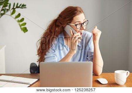 Headshot Of A Successful Businesswoman Looking Excited Talking On The Cell Phone. Portrait Of A Fema