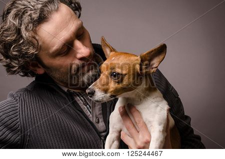 Man with his Jack Russell Terrier studioshot