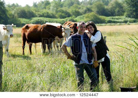 Happy couple of farmers