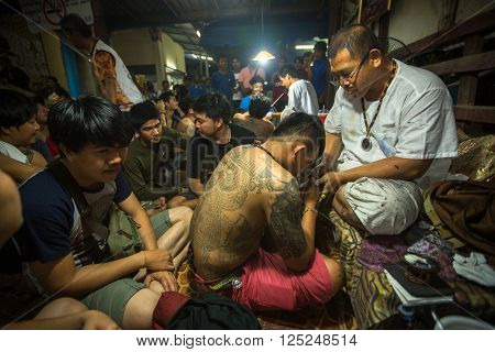 WAT BANG PHRA, THAILAND - MAR 18, 2016: Unknown participants of Master Day Ceremony at able Khong Khuen (spirit possession) during the Wai Kroo ritual at Bang Pra monastery, about 50 km of Bangkok.