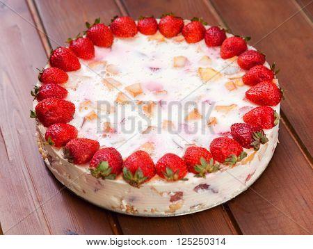 Cake with strawberries gelly yogurt and cherries. ** Note: Shallow depth of field