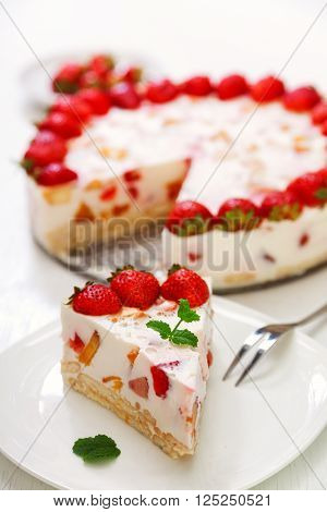 Cake with strawberries gelly yogurt and cherries. Surface view. Isolated on white background. ** Note: Shallow depth of field